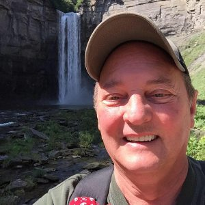 Dave Andrus in front of a waterfall