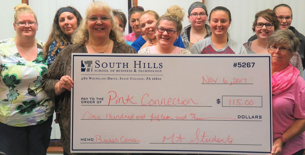 Medical Assistant students with donation check