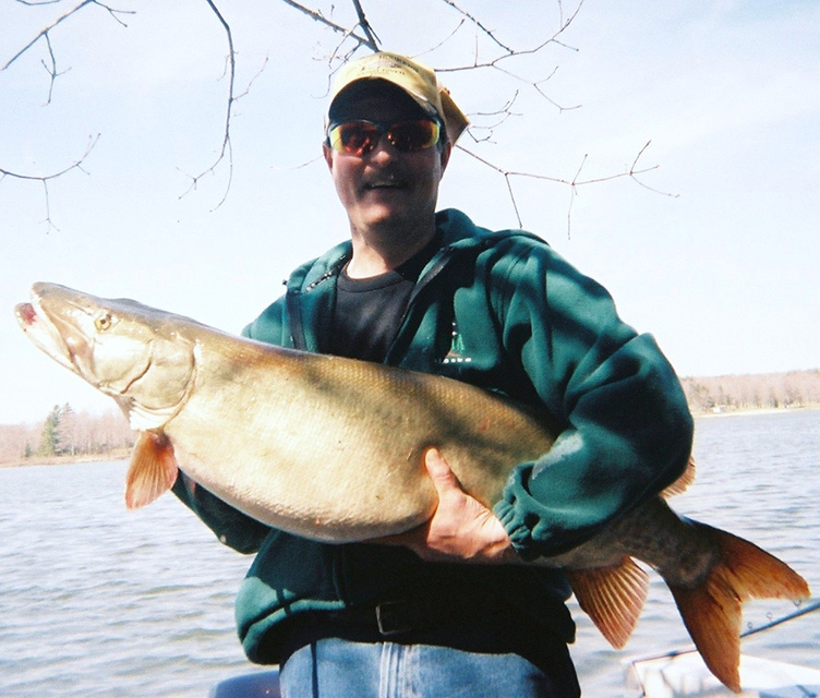 Mark Gentzel with a huge fish he caught