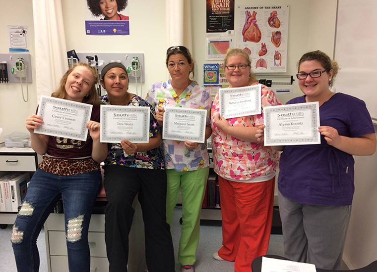 Healthcare students earn certificates.