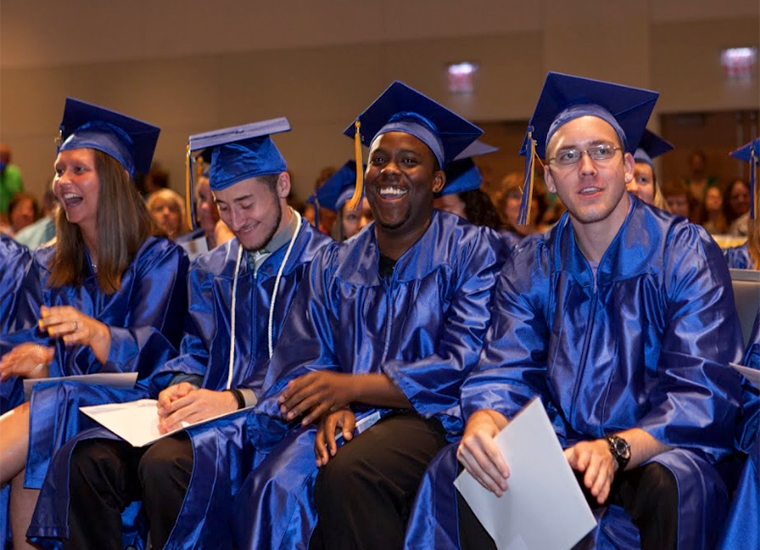 Students are shown at their commencement ceremony.