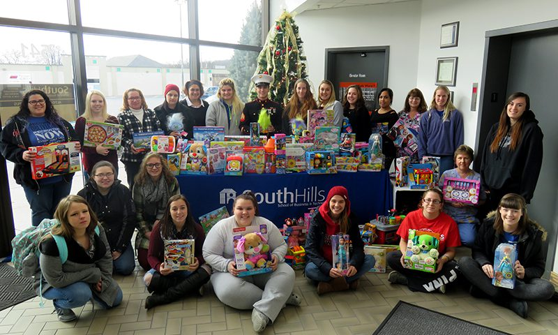 This photo shows Altoona students with toy donations for Toys for Tots